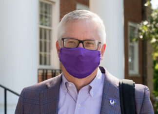Portrait of President Phil Oldham wearing a face covering.