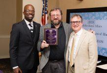 Photo of Troy Smith receiving award